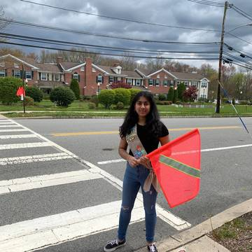 Top story 3b8651bdce385b5e3219 khushi parekh with her flag pedestrian safety system at juniper village