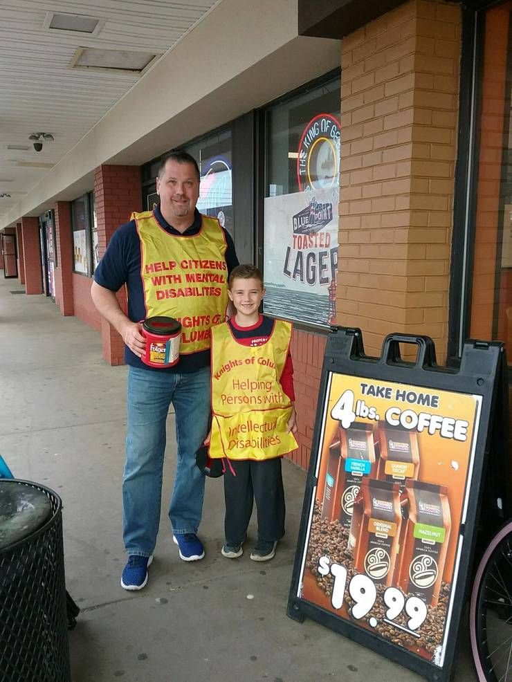 Knights member Robbi Matusz and his son Mateo canning outside Dunkin Donuts