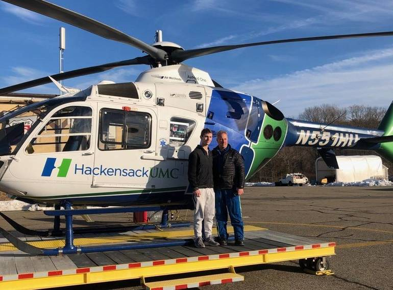 Kyle Cooney goes back to thank the paramedic who helped save his life.jpg
