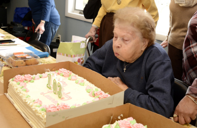 Laura Teste blows out candles on her 103rd birthday cake at Forest Road Park in Fanwood.