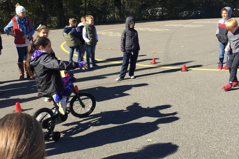 Learning how to signal in Bike Safety.JPG
