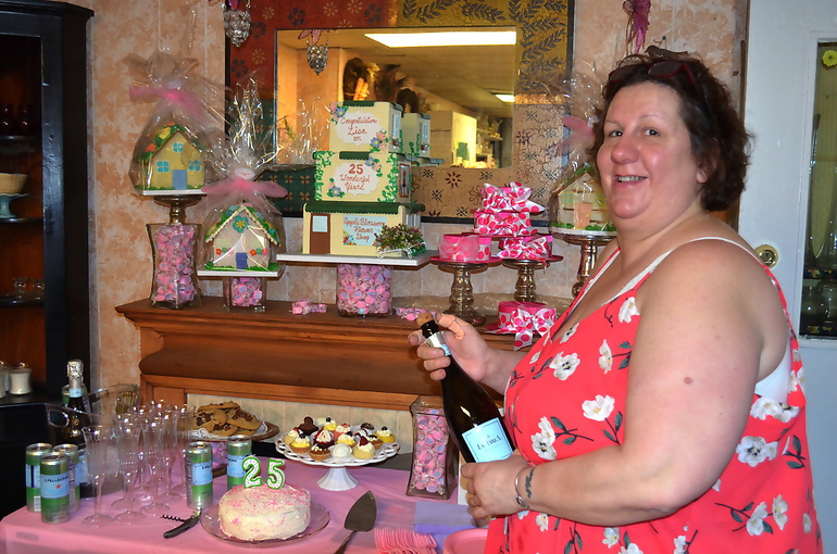 Lisa Mohn pops the cork on the bubbly at Apple Blossom Flower Shop in Scotch Plains