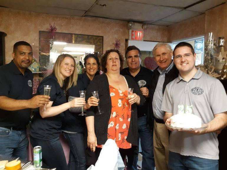 Scotch Plains officials White, Elizabeth Stamler, Margaret Heisey, Lisa Mohn, Ted Spera, Al Smith and Tom Strowe celebrate Apple Blossom Flower Shop's silver anniversary.
