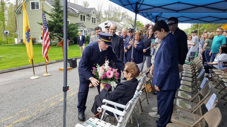 Lou Bizzari of Roxbury give flowers to wife.jpg