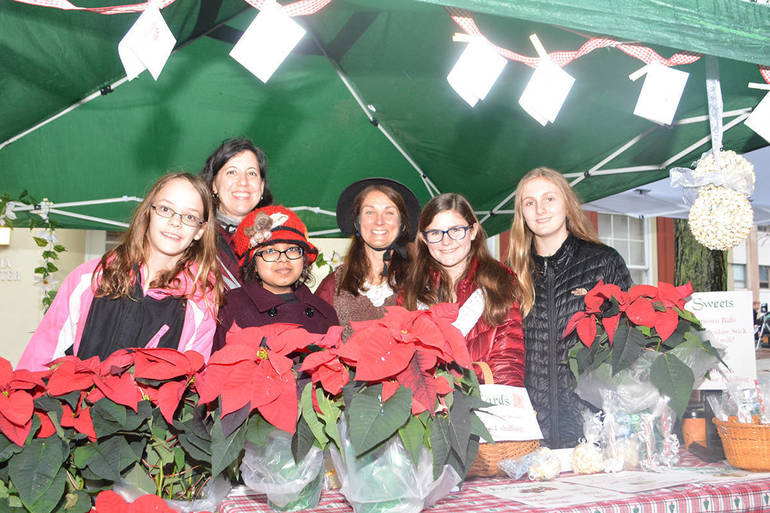 Local Girls Scouts selling Pointsettias to fund their projects.JPG