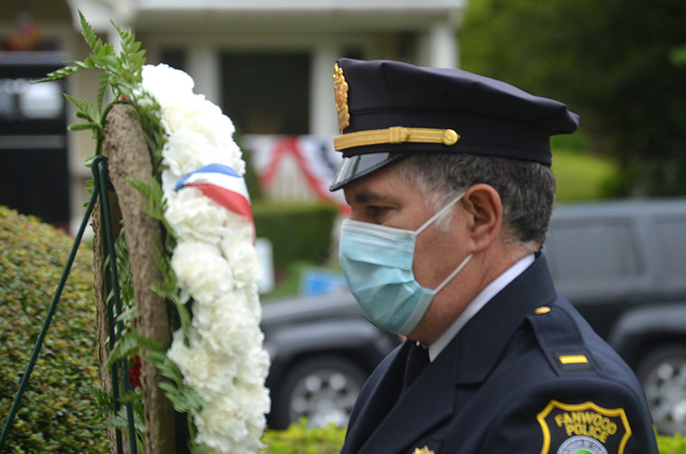 Fanwood Police Lt. Frank Marrero lays a wreath.