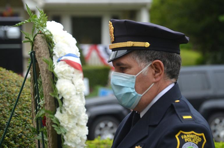 Fanwood Police Lt. Frank Marrero lays a wreath.