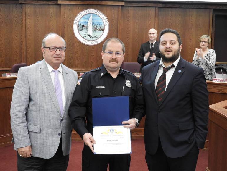 (l to r) MAYOR PAT MENNA, RB FIREMAN FRANK WOODS & COUNCIL HAZIM YASSIN.  WOODS WAS HONORED FOR OUTSTANDING SERVICE.jpg