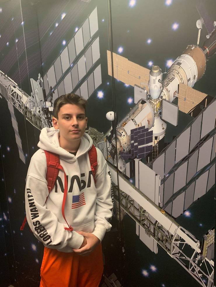 Luka in front of ISS mural.jpg