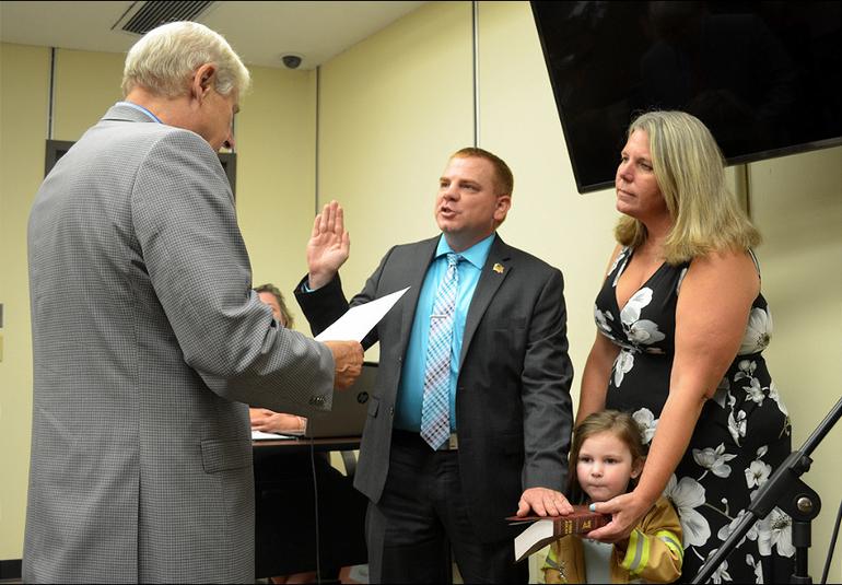 Scotch Plains Mayor Al Smith swears in Ryan Edwish as a new firefighter