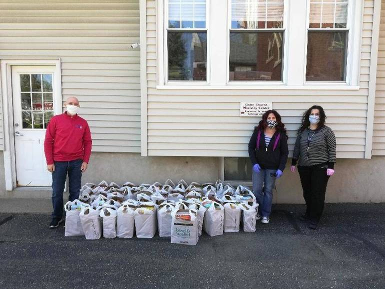 Marc Foti (President of teachers association), Judy Perez and Margie Rivera (VP & President of office workers association) deliver food and supplies to New Hope Community Ministries in Prospect Park, 5-12-2020.jpg