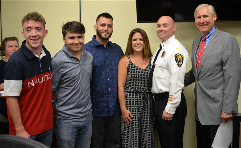 Mayor Al Smith with Lt. Michael Tardi and his family.png