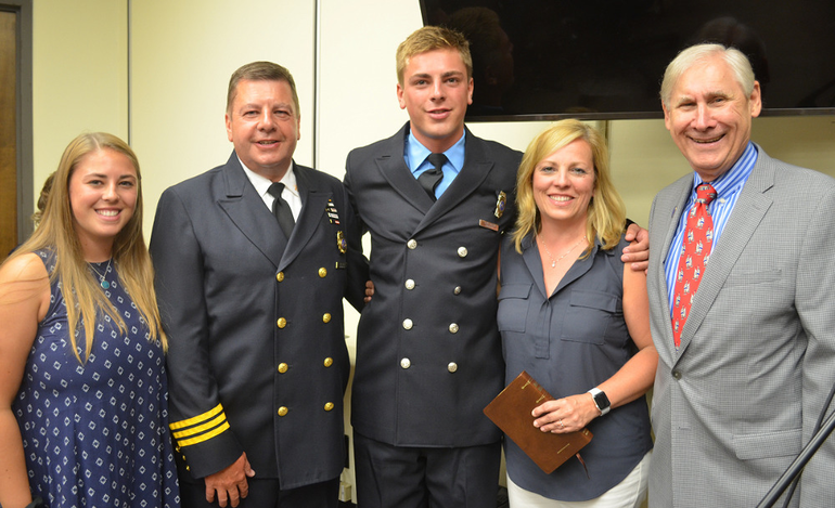 Mayor Al Smith with new firefighter Sean Biglin.png