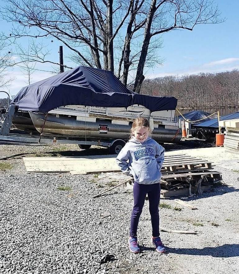 Mackayla Banker finds a boat.jpg