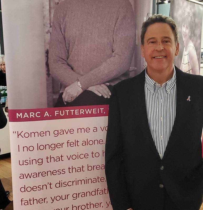 Marc A. Futterweit Standing Next to His Story.jpg
