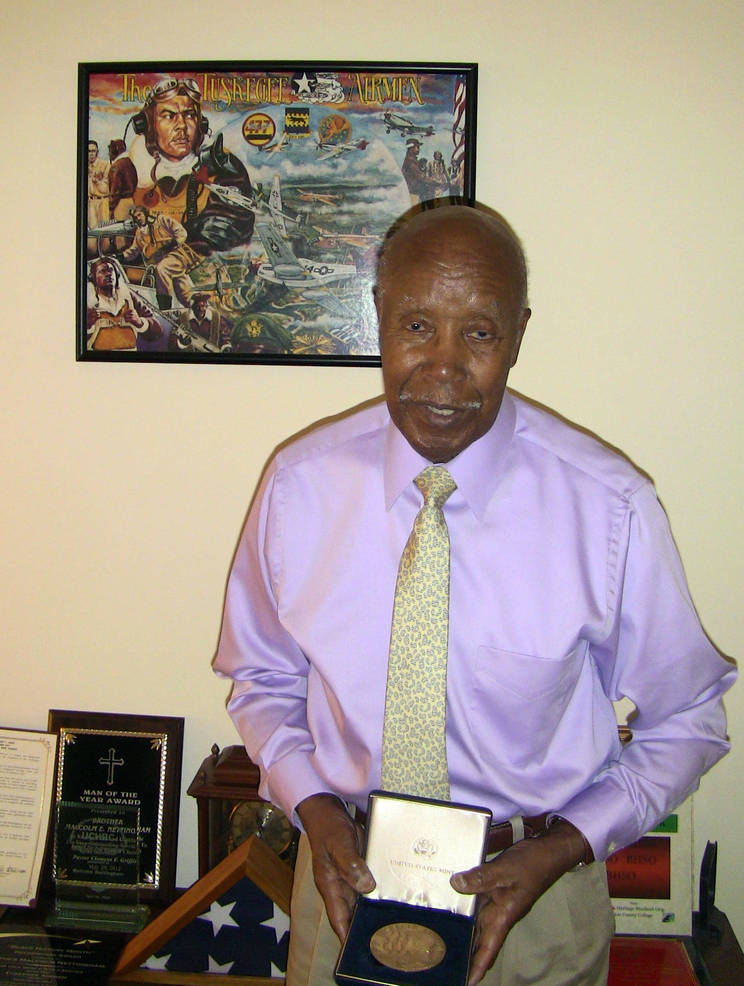 Tuskegee Airman Malcolm Nettingham of Scotch Plains with his Congressional Gold Medal.