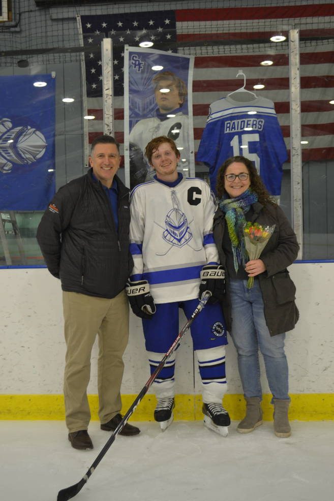 #15, Captain, Will Mauer with his parents at Scotch Plains-Fanwood hockey Senior Night.
