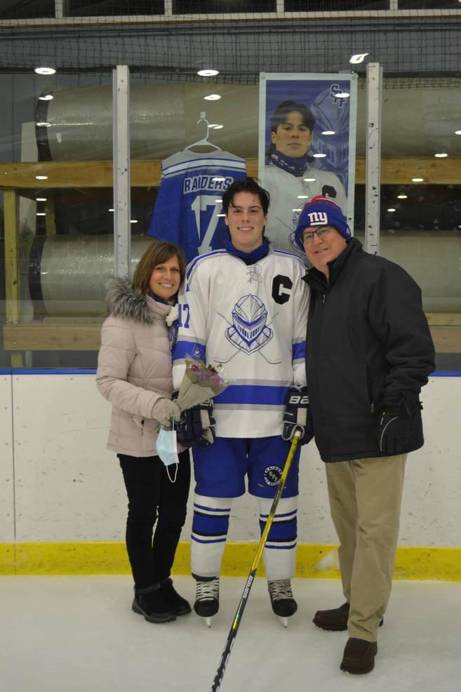 #17, Captain, Lucas Mackey with his parents at Scotch Plains-Fanwood hockey Senior Night.