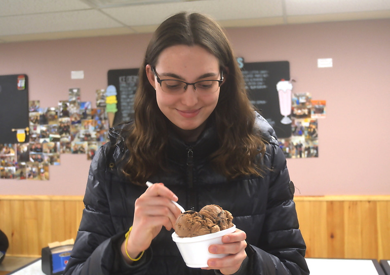Mary Huby digs into Chocoholic ice cream at Rocko's.png