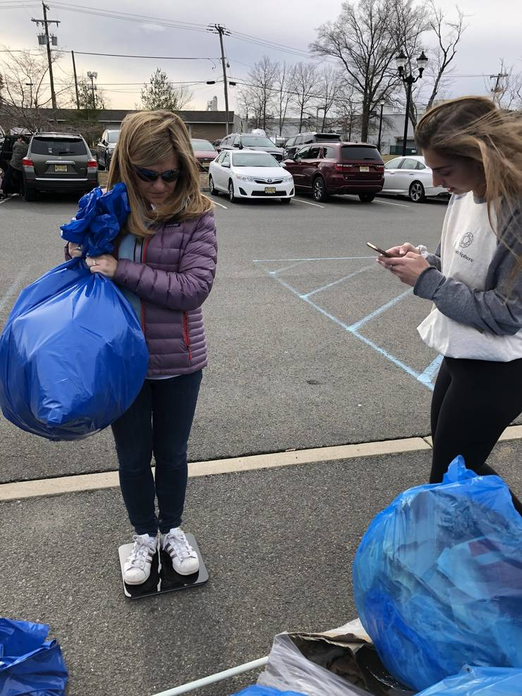 March 24 Clean Up - Weighing the Litter - Jeanne and Val.jpeg