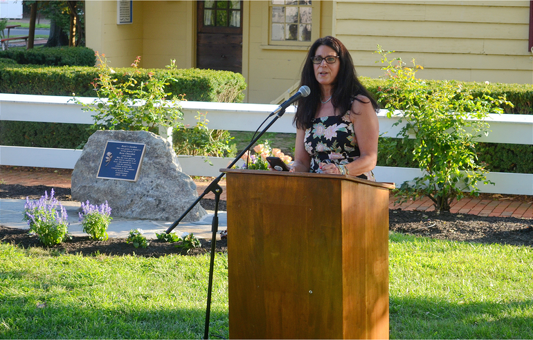 "Scotch Plains Deputy Manager Margaret Heisey speaks at the dedication of ""Rose's Garden."""