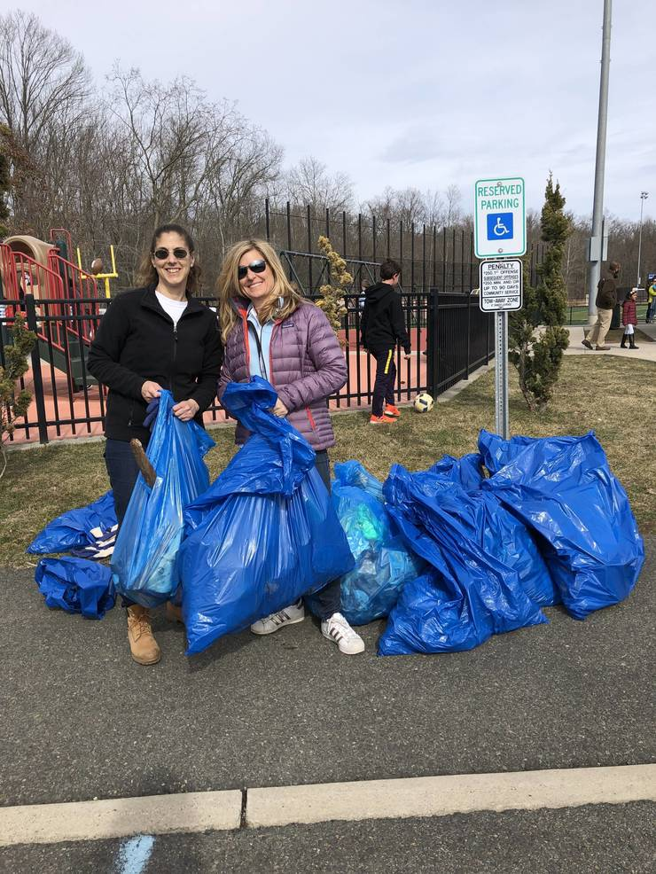 March 24 Clean Up - Jeanne and Kim with All Filled Bags.jpeg