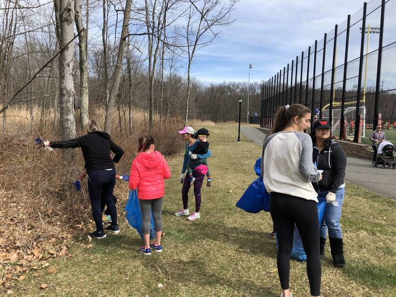 March 24 Clean Up - In Woods By Turf Field.jpeg