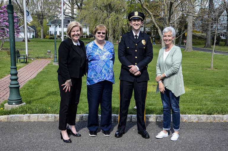 Fanwood police lieutenantDan Kranz with Mayor Colleen Mahr and Council members Kathy Mitchell and Trisha Walsh.