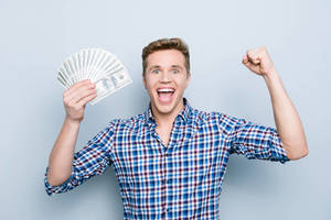 Carousel image 92c5c65c804fbabf51d4 man money dollar bills happy home seller