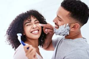 Carousel image bdb50c0eb5e12581b566 medium man shaving his beard and being playful with his wife  002   1