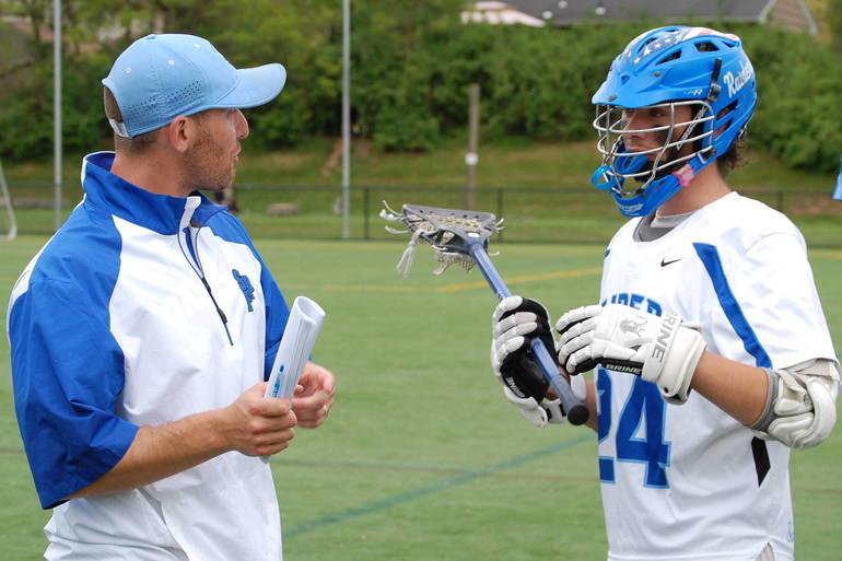 Scotch Plains-Fanwood boys lacrosse coach Nick Miceli talks to his players.