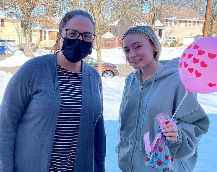 Michelle Mauer delivers gift to Scotch Plains-Fanwood HS senior Holly Nelson.