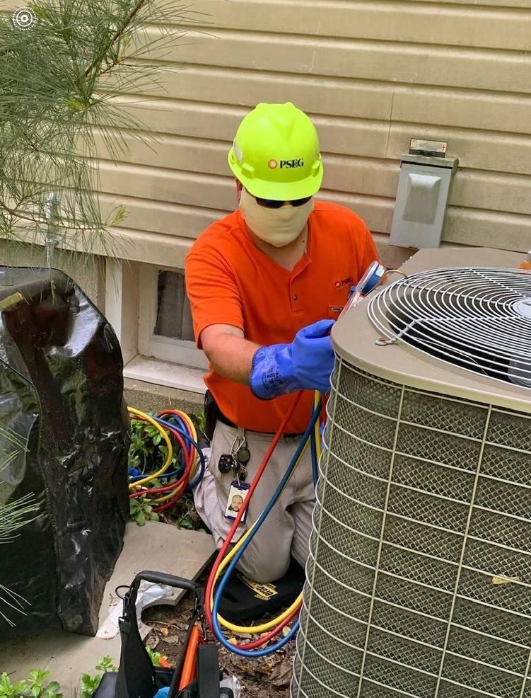 Michael Vega - AS tech, repairing air conditioner May 26 2020.jpg