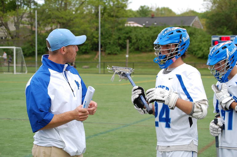Scotch Plains-Fanwood lacrosse coach Nick Miceli talks with players.