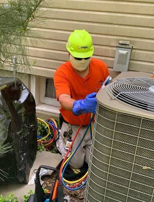 Carousel image c75ca5fb7465ce9d5af6 michael vega   as tech  repairing air conditioner may 26 2020