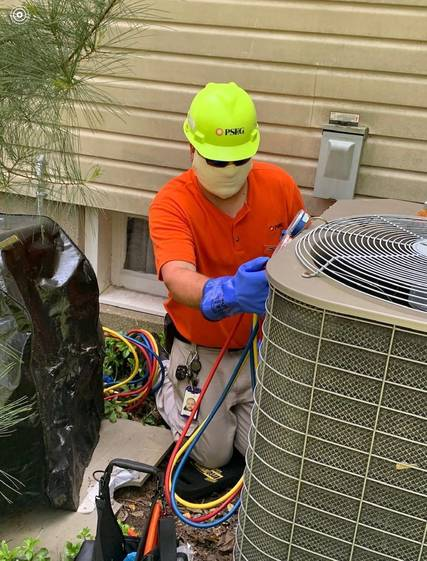Top story c75ca5fb7465ce9d5af6 michael vega   as tech  repairing air conditioner may 26 2020