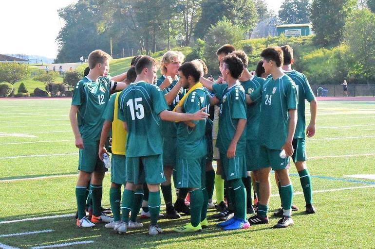 MKHS Boys Soccer Team Huddle.2019.JPG