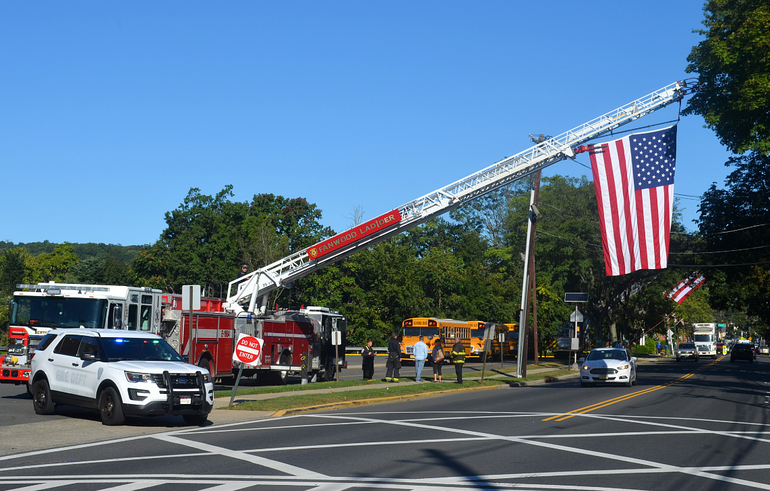 Flags fly in Scotch Plains awaiting the Malcolm Nettingham's funeral procession.