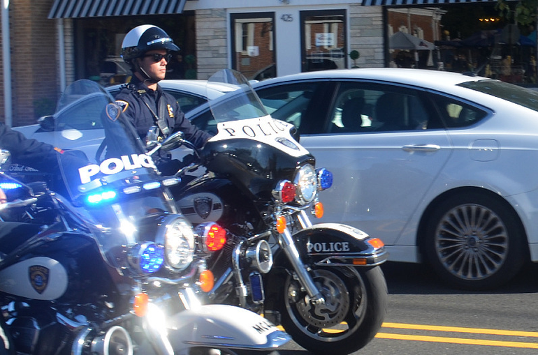 Malcolm Nettingham's funeral procession through Scotch Plains included a police escort.
