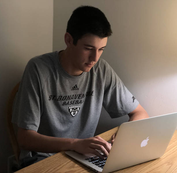 Donovan Moffat works on a school assignment