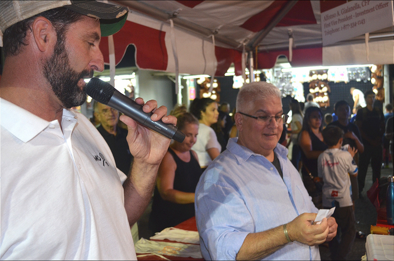 Father John Paladino, pastor of St. Bart's, announces the grand prize winner at the St. Bart's Italian Festival in Scotch Plains on Monday