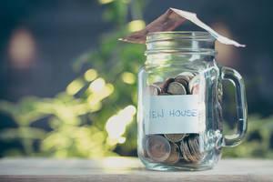Carousel image 27c7e9cb783970b29ade money in jar new home saving