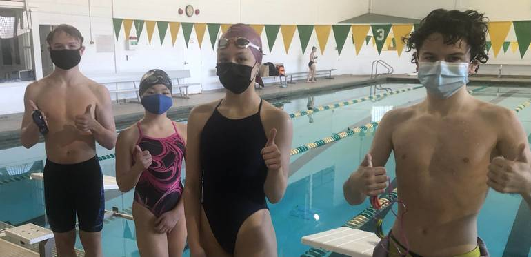 Wardlaw+Hartridge Middle School swimmers Tom O'Connor, Coco Lee, Phoebe Kaplan and Sammy Faust give a thumbs-up after the record swim.