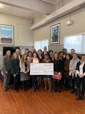 Carousel_image_3f59b11d0f3c604a8a65_m_t_bank_presents_check_to_give2paterson_group_photo__1_