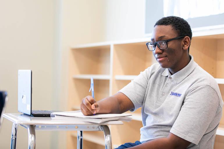 Naquan Tatum, a freshman at Camden Prep High School, participates in the high school's robotics program.