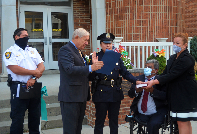 Scotch Plains Mayor Al Smith and Police Chief Ted Conley swear in the department's newest officer Valerie Aguirre.