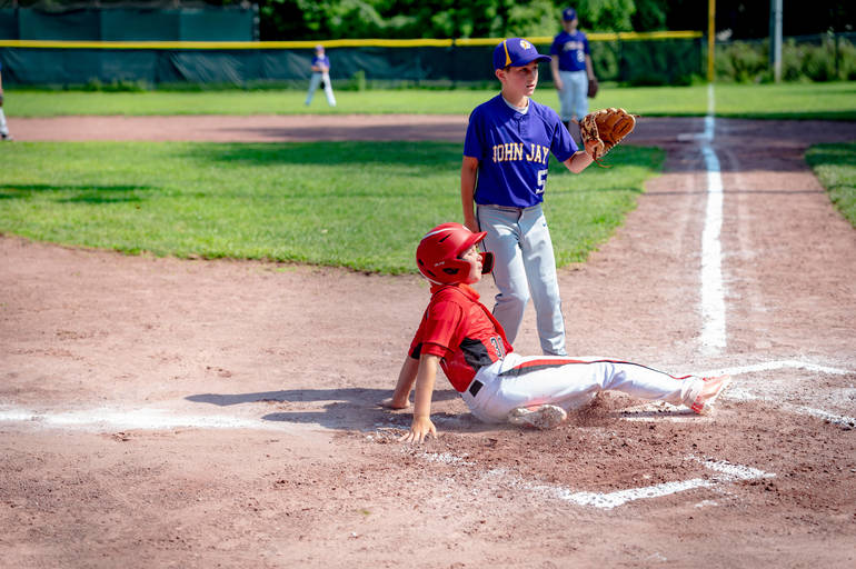 Nicholas Morales slides into first base.JPG