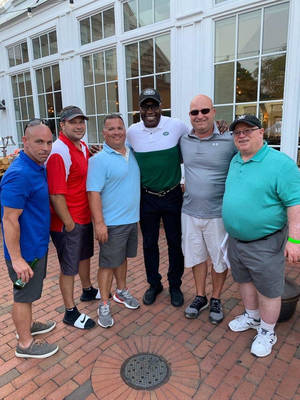 Carousel image 57a8fb1bd4914f89d3df nick delcalzo and group golf outing from frank d amico