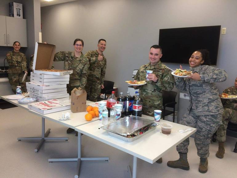 NJ Guard with pizza.jpg