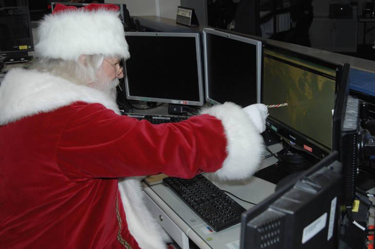 NORAD - Santa reviews his flight plan.JPG